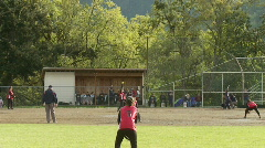 Hit to 3rd base in girls softball game Stock Footage