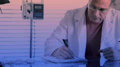 Doctor taking notes.mov Stock Footage