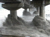 Stock Video Footage of Extreme River Flood Under Bridge