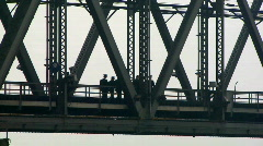 Chinese soldiers walking across bridge Stock Footage