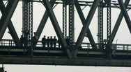 Chinese soldiers walking across bridge Stock Footage