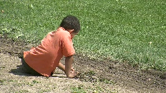 Boy playing in dirt - stock footage
