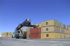 Container freight loaded by crane - stock footage