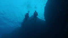 Two scuba divers at coral reef, overhead shot, red sea Stock Footage