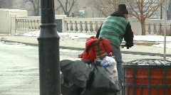 Homeless person and bike full of bags Stock Footage