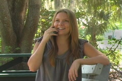 Teen Girl in the Park Talking on a Cell Phone Stock Footage
