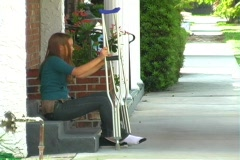 Teen Girl Walking with Crutches-1 Stock Footage