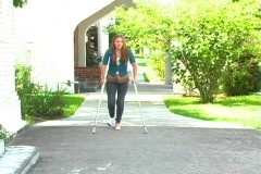 Teen Girl Walking with Crutches-3 Stock Footage