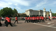 Stock Video Footage of Guardsmen marching to Buckingham Palace London England UK