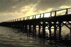 Old bridge pan to lighthouse Stock Footage