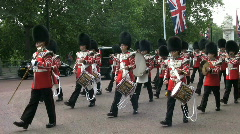 Guards band marching from Buckingham Palace London England UK Stock Footage