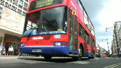 Shops, black cabs and red buses in Oxford Street London England UK Stock Footage