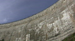 Water sprays out the bottom of lake Spaulding dam Stock Footage