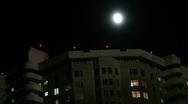 Stock Video Footage of Midnight moon on house
