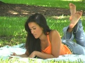 Beautiful Young Latina Reading Outdoors (1) Stock Footage