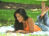 Stock Video Footage of Beautiful Young Latina Reading Outdoors (2)