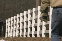 Fence with foreman walking through - stock footage