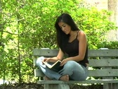 Stock Video Footage of Beautiful Young Latina Reading Outdoors (3)
