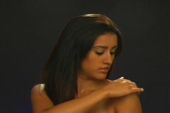 Beautiful Latina Applies Lotion to Her Left Shoulder Stock Footage