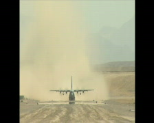 C-130 Hercules take off on dust runway in Afghanistan Stock Footage