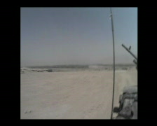 Driving a military jeep in the desert of Afghanistan - stock footage