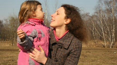 Girl fondles mother Stock Footage