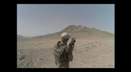 Stock Video Footage of Dutch soldier shooting a grenade launcher in the desert of Afghanistan