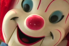 Creepy Clown Doll's Face coming close - stock footage