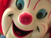 Stock Video Footage of Creepy Clown Doll's Face coming close