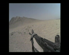 Firing a rifle DIMACO in the desert of Afghanistan - stock footage