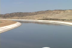 Stock Video Footage of Water from the Sierra Nevada mountains runs through the Los Angeles aqueduct.