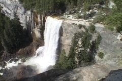 Vernal Falls in Yosemite National Park spills over its rocky edge to the river - stock footage