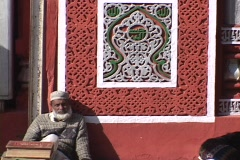 A Muslim man sits outside mosque after prayer. Stock Footage