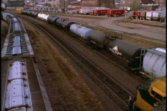 A freight train travels past the Omaha, Nebraska skyline. Stock Footage