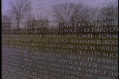 The Vietnam War Memorial reflects the image of a man. Stock Footage
