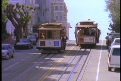Cable cars pass on hilly San Francisco street. Stock Footage