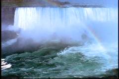 A Maid of the Mist tour boats approaches the mist of Niagara Falls. Stock Footage