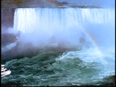 Stock Video Footage of A Maid of the Mist tour boats approaches the mist of Niagara Falls.