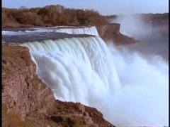 Water cascades over Niagara Falls. Stock Footage
