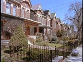Stock Video Footage of Identical duplexes line a suburban neighborhood in Toronto.