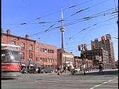 Stock Video Footage of Cars and trolleys cross an intersection in Toronto.