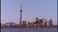 Stock Video Footage of The CN Tower stands in the Toronto skyline.