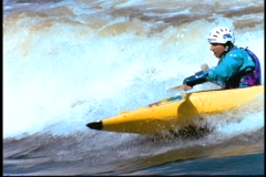 A man moves through rapids in a kayak. Stock Footage