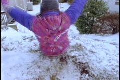 Children slide down a slick, snowy hill. Stock Footage