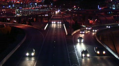 Vehicles enter a freeway in rush hour at night. - stock footage