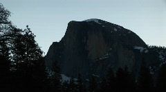 A silhouetted mountain during the golden-hour Stock Footage