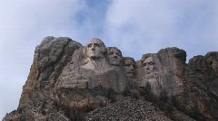 Clouds drift slowly past the tops of the four presidents in Stock Footage