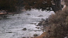 A stream flows over rocks in winter. Stock Footage