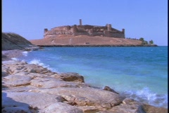 The ruins of an Arab castle stand beside the Euphrates River. Stock Footage