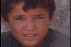 A young Arab boy rubs his eyes. Stock Footage
